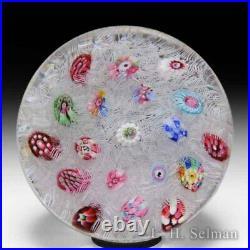 Baccarat spaced zodiac millefiori on upset muslin glass paperweight