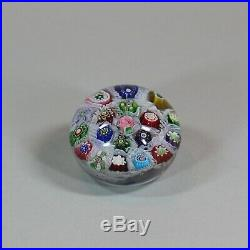 Clichy millefiori chequer paperweight, circa 1850, set with variously assorted c
